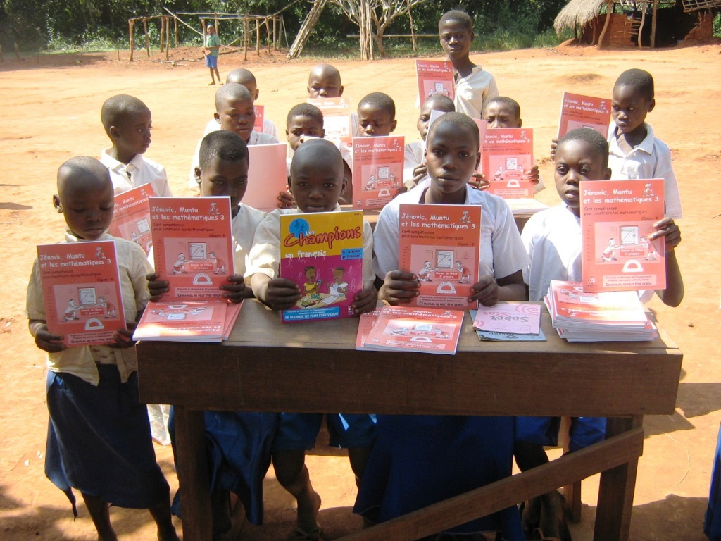 Students with language arts work books in Epi, Democratic Republic of the Congo 2016