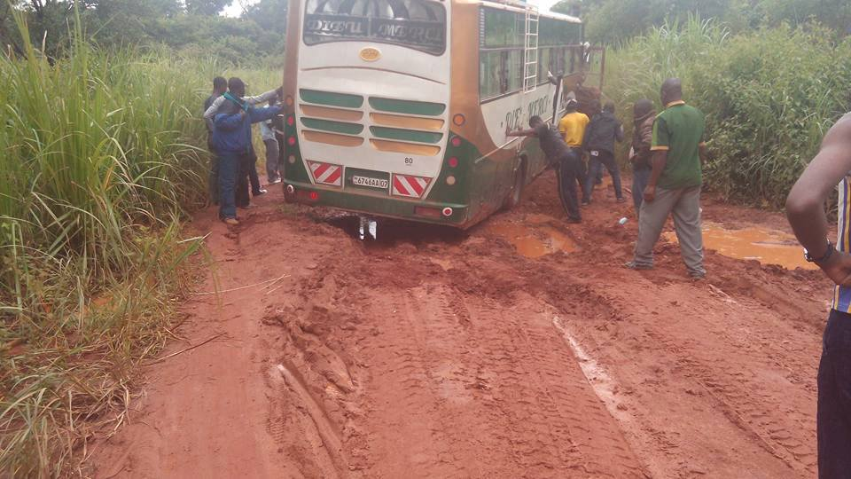 Bus stuck in the mud on the road from Durba, DRC to Dungu, DRC.